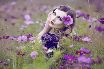 Beautiful woman in a flower field