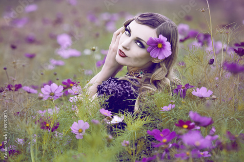 canvas print picture Beautiful woman in a flower field