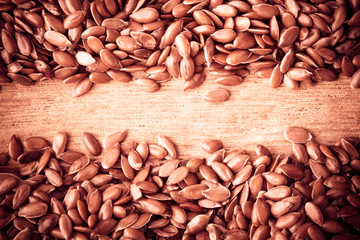 Healthy diet. Flax seeds linseed border on wooden background