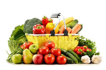 Shopping basket with groceries isolated on white