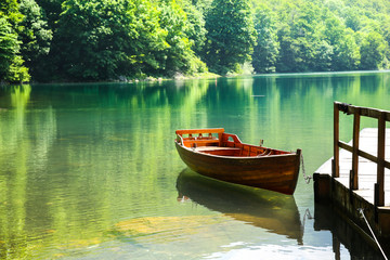 Wooden boat on mountain lake