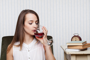 Beautiful girl drinking red wine