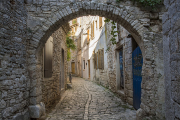 Old and narrow street, paved of cobble stones, Bale, Croatia