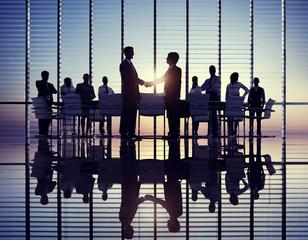 Two Businessmen Handshaking in Meeting