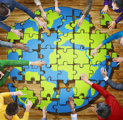 People with Jigsaw Puzzle Forming Globe illustration