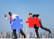 Two Businessmen with Puzzle Piece