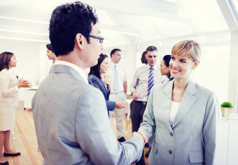 Two Business Person Handshaking in the Office