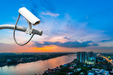 CCTV Camera or surveillance operating with city in background