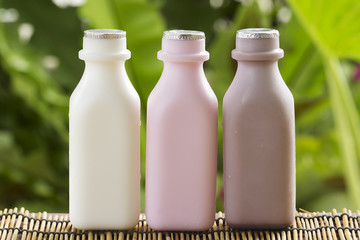 Strawberry, chocolate and fresh milk bottles