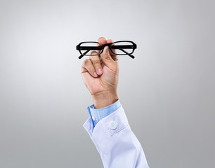 Optician doctor hold with eye glasses