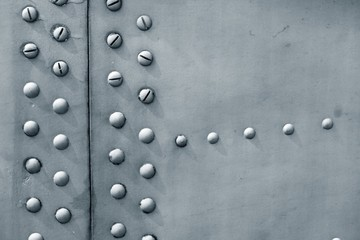 Riveted metal surface