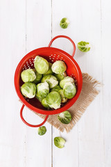 Brussels sprouts over rustic wooden background