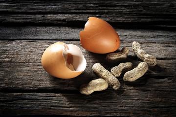 Betel Nut and eggs shell on wood floor