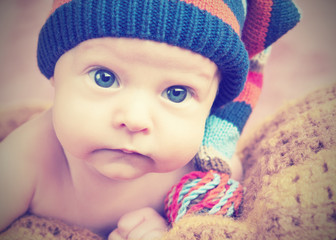 cute newborn baby in knitted hat cap