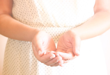 closeup of young woman hands. hands outstretched in cupped shape