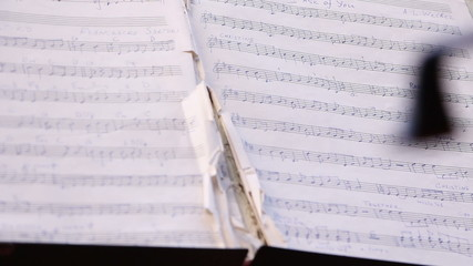 Musician playing on cello, notes before