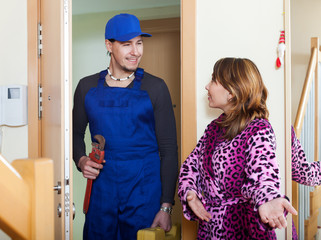 housewife meeting service worker at home