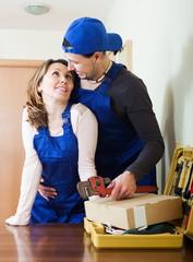 Two joyful workers flirting