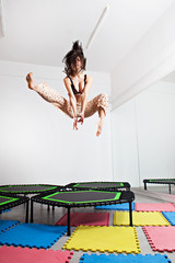 Jumping young woman on a trampoline