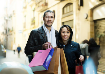 couple with shopping bags at  european street