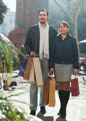 Joyful couple with purchases