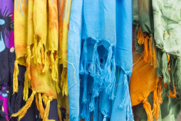 Colorful scarves at a market in Greece. Colors of textiles