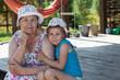 Smiling senior grandma and happy grandchild embracing on veranda