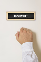 Male patient knocking on Psychiatrist door