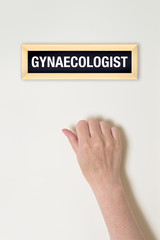 Female hand is knocking on Gynaecologist door