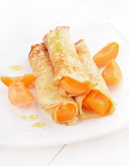 Crepes with apricot slices