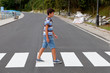 Teenager through a zebra crossing