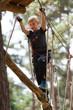 canvas print picture - Junge beim Klettern