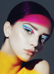 model in studio with bright make up