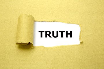 Truth text appearing behind torn brown paper.