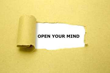 Open Your Mind text appearing behind torn brown paper.