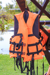 Orange life jackets and pool.