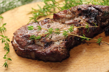 Roasted spiced pork steak with thyme branches