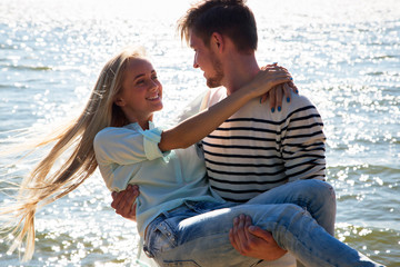 Young man holding on the hands his girlfriend