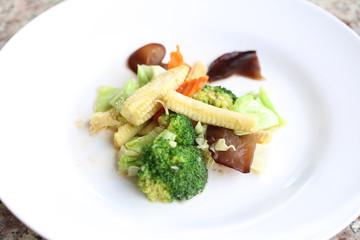 Stir mixed vegetables.