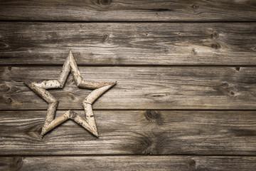 Weihnachtlicher Holz Hintergrund mit Stern