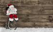 Постер, плакат: Santa Claus oder Nikolaus auf dem Fahrrad