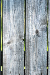 old wooden fence with barbed wire on top