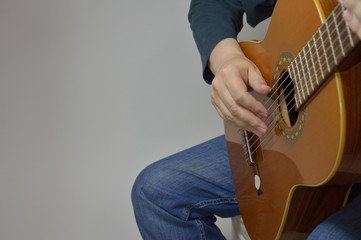 Hands and guitar