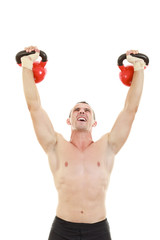 fitness athletic man holding and lifting high up red kettlebells
