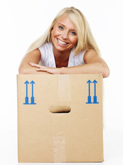 Woman rests on her moving box