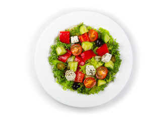 Plate with fresh greek salad isolated