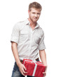 young casual man hoding christmas gift