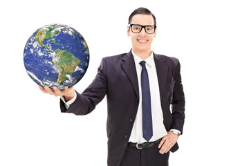 Happy young businessman holding the earth