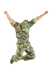 soldie in camouflage uniform and hat jumping