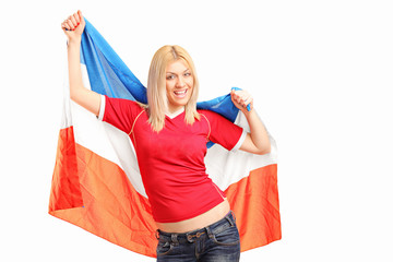 Female sports fan waving a Dutch flag